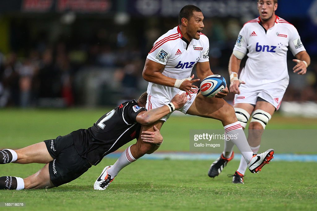 Robbie Fruean of Crusaders is tackled during the Super Rugby round eight match between the Sharks and Crusaders from Kings Park on April 05, 2013 in Durban, South Africa.