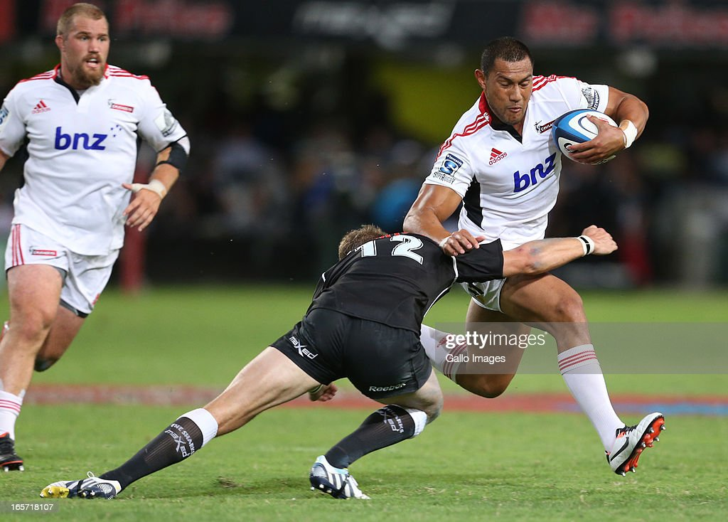 Robbie Fruean of Crusaders (R) is tackled during the Super Rugby round eight match between the Sharks and Crusaders from Kings Park on April 05, 2013 in Durban, South Africa.