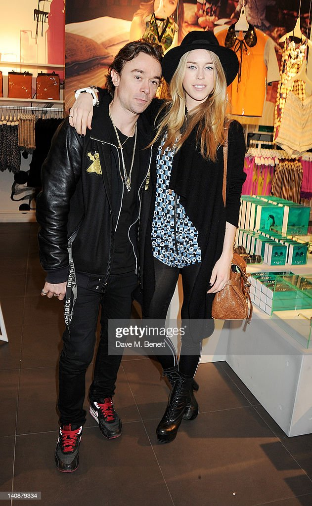 Robbie Furze (L) and <a gi-track='captionPersonalityLinkClicked' href=/galleries/search?phrase=Mary+Charteris&family=editorial&specificpeople=4361110 ng-click='$event.stopPropagation()'>Mary Charteris</a> attend the launch of Italian fashion house Marni's collection for H&M at H&M Regent Street on March 7, 2012 in London, England.