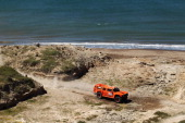 Robbie Gordon of the USA drives his Hummer through the sand dunes on stage one of the 2012 Dakar Rally from Mar Del Plata to Santa Rosa de la Pampa...