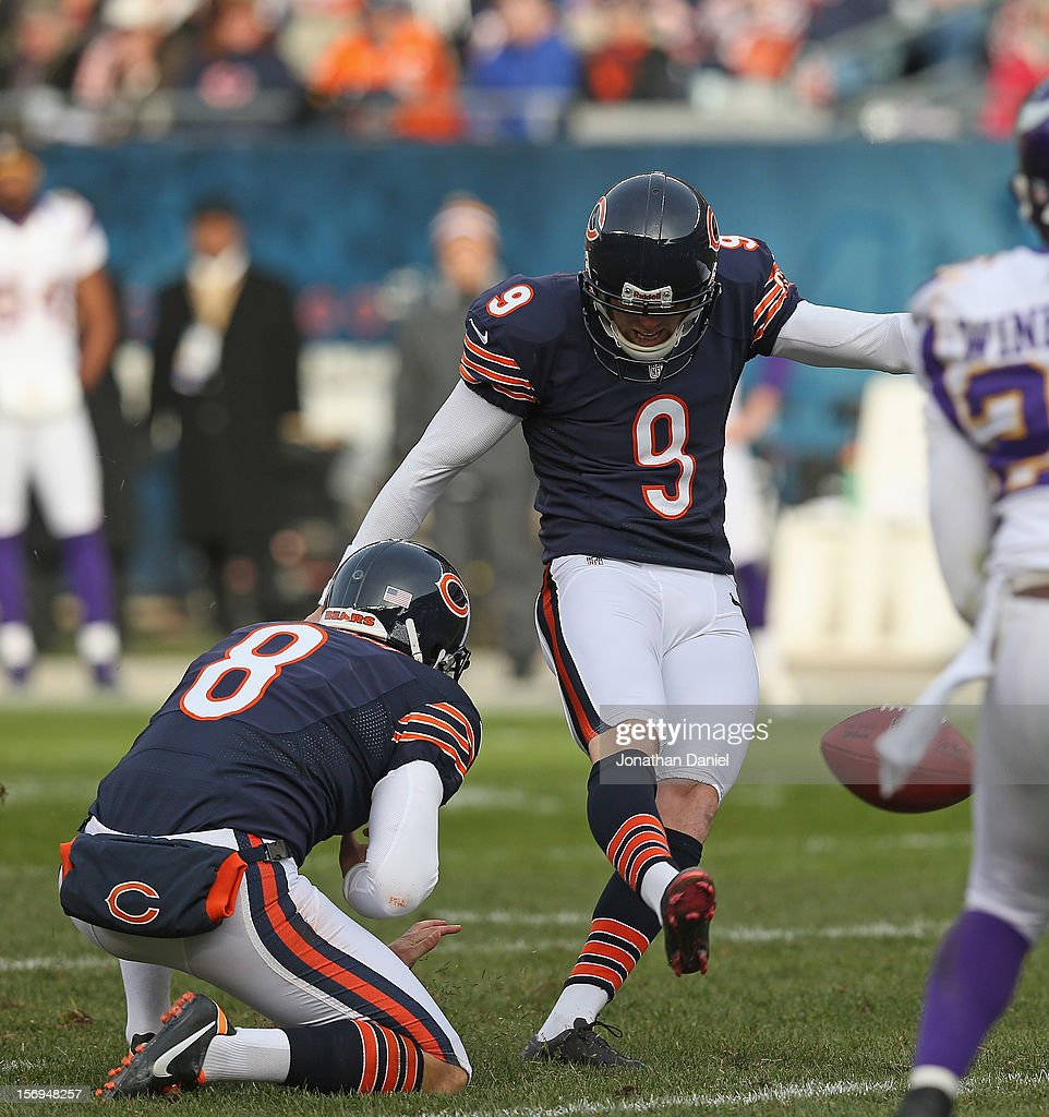 Robbie Gould #9 of the Chicago Bears kicks a 47 yard field goal out of the hold of Adam Podlesh #8 against the Minnesota Vikings at Soldier Field on November 25, 2012 in Chicago, Illinois. The Bears defeated the Vikings 28-10.