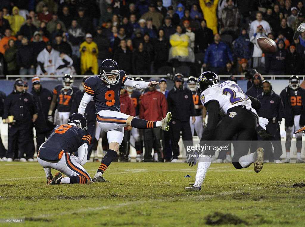 Robbie Gould #9 of the Chicago Bears kicks the game winning field goal against the Baltimore Ravens during overtime on November 17, 2013 at Soldier Field in Chicago, Illinois. The Chicago Bears defeated the Baltimore Ravens 23-20 in overtime.