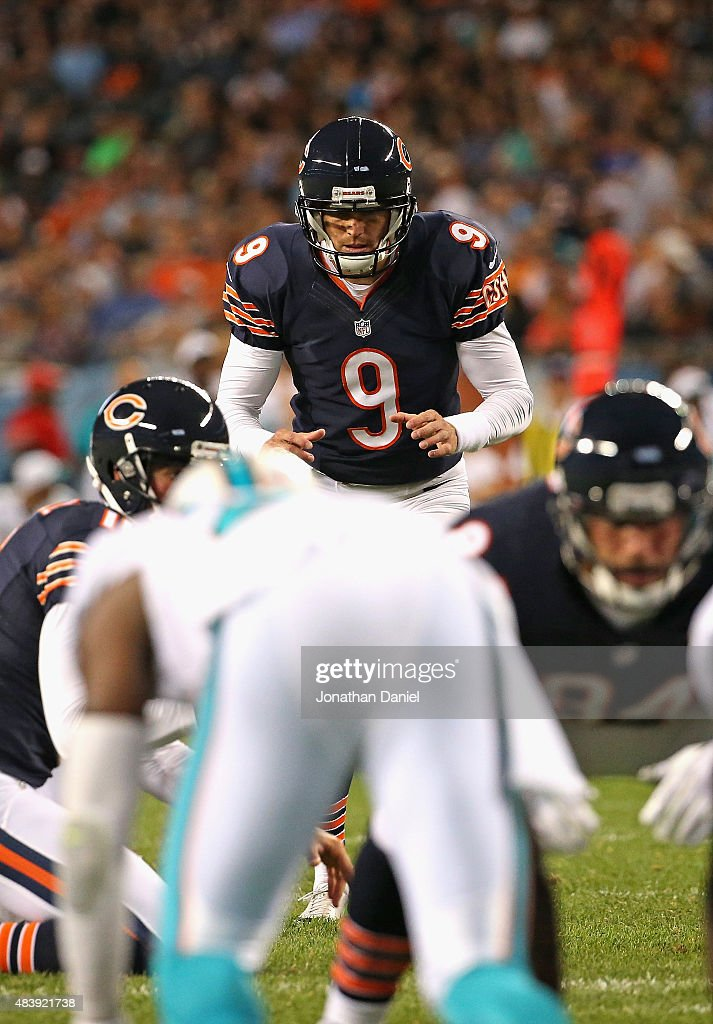 Robbie Gould #9 of the Chicago Bears prepares to kick a field goal against the Miami Dolphins during a preseason game at Soldier Field on August 13, 2015 in Chicago, Illinois. The Bears defeated the Dolphins 27-10.