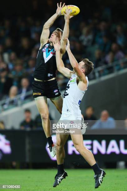 Robbie Gray of the Power compete for the ball over Sam Docherty of the Blues during the round five AFL match between the Port Adelaide Power and thew...