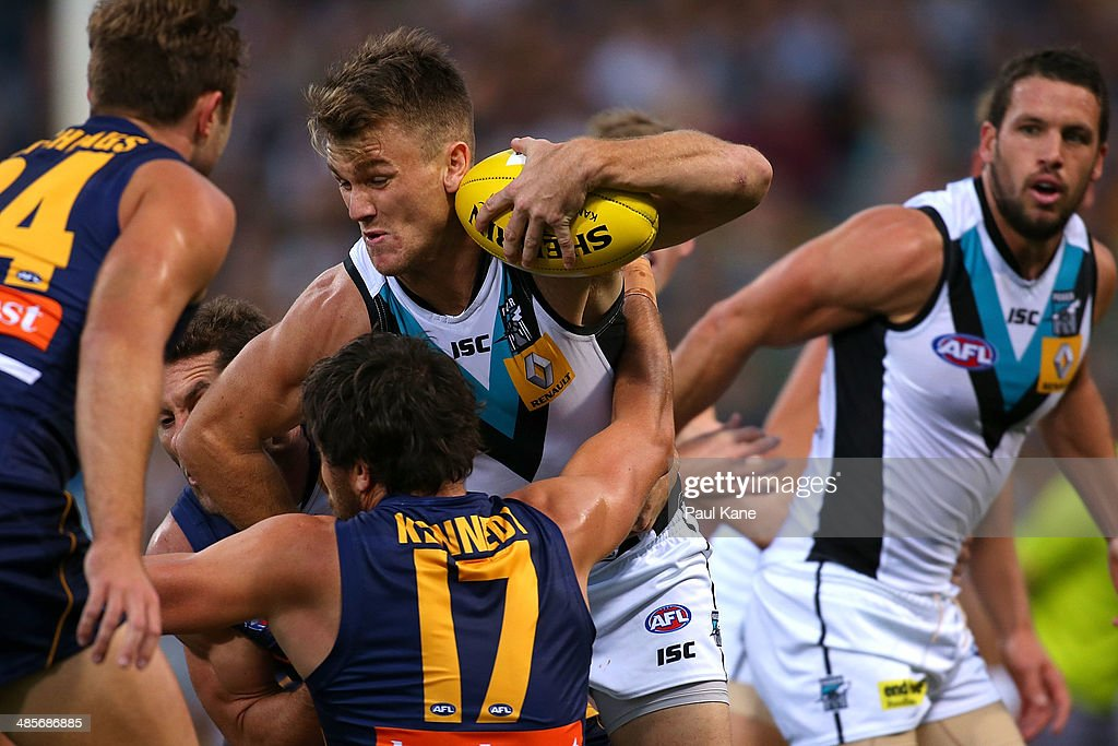 Robbie Gray of the Power looks to break from a tackle from Darren Glass and Josh Kennedy of the Eagles during the round five AFL match between the West Coast Eagles and the Port Power at Patersons Stadium on April 19, 2014 in Perth, Australia.