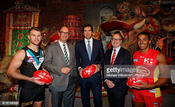 Robbie Gray of the Power Power President David Koch AFL CEO Gillon McLachlan Suns Chairman Tony Cochrane and Touk Miller of the Suns pose for a...