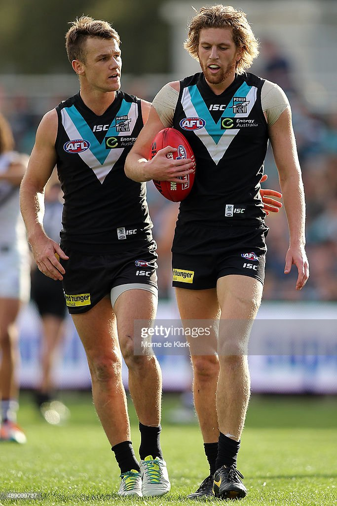 Robbie Gray of the Power speaks to teammate Aaron Young during the round eight AFL match between the Port Adelaide Power and Fremantle Dockers at Adelaide Oval on May 10, 2014 in Adelaide, Australia.
