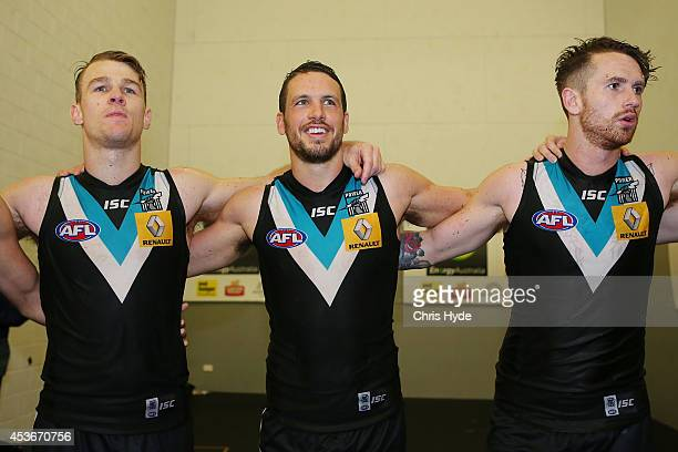 Robbie Gray Travis Boak and Cam O'Shea of the Power sing the team song after winning the round 21 AFL match between the Gold Coast Suns and the Port...