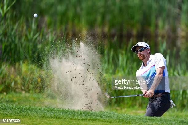 Robbie Greenwell of Canada hits a bunker shot on the third hole during the final round of the Mackenzie Investments Open at Club de Golf Les Quatre...