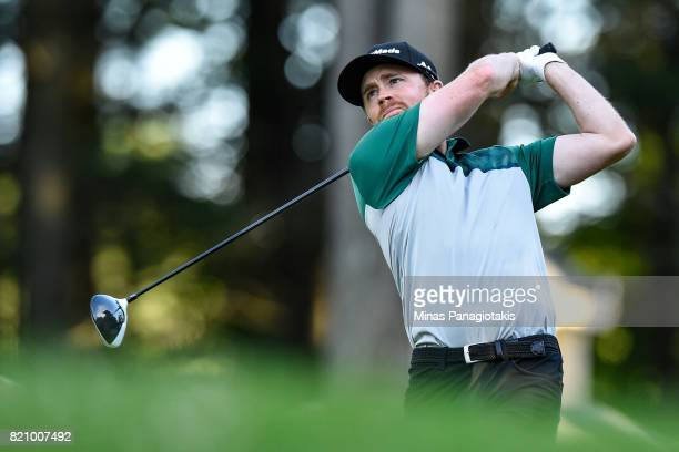 Robbie Greenwell of Canada hits his tee on the first hole during round three of the Mackenzie Investments Open at Club de Golf Les Quatre Domaines on...