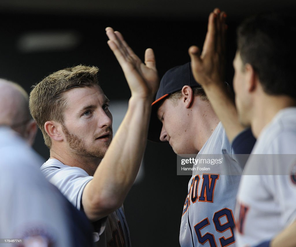 Robbie Grossman #19 of the Houston Astros celebrates scoring a run against the Minnesota Twins during the third inning of the game on August 3, 2013 at Target Field in Minneapolis, Minnesota.