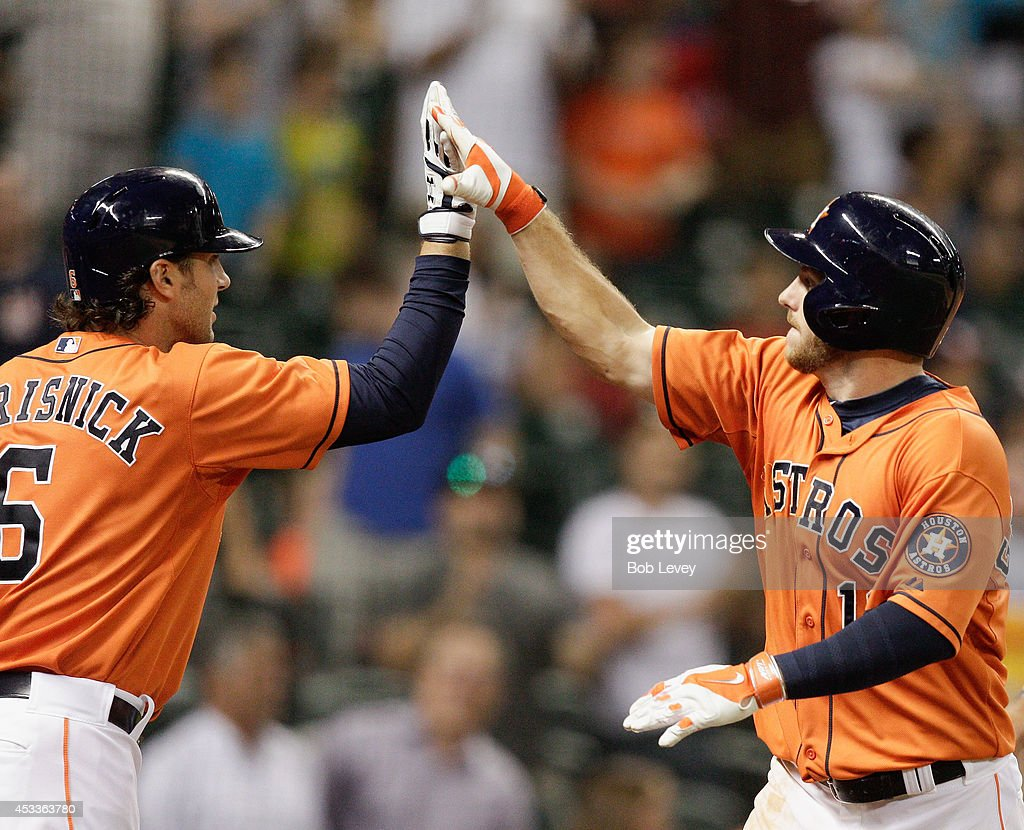 Robbie Grossman #19 of the Houston Astros high fives his teammate <a gi-track='captionPersonalityLinkClicked' href=/galleries/search?phrase=Jake+Marisnick&family=editorial&specificpeople=10507748 ng-click='$event.stopPropagation()'>Jake Marisnick</a> #6 after hitting a home run in the eighth inning against the Texas Rangers at Minute Maid Park on August 8, 2014 in Houston, Texas.