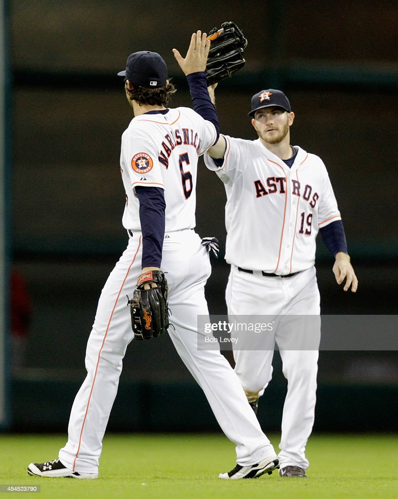 Robbie Grossman #19 of the Houston Astros high fives <a gi-track='captionPersonalityLinkClicked' href=/galleries/search?phrase=Jake+Marisnick&family=editorial&specificpeople=10507748 ng-click='$event.stopPropagation()'>Jake Marisnick</a> #6 after the final out as the Houston Astros beat the Los Angeles Angels of Anaheim 8-3 at Minute Maid Park on September 2, 2014 in Houston, Texas.