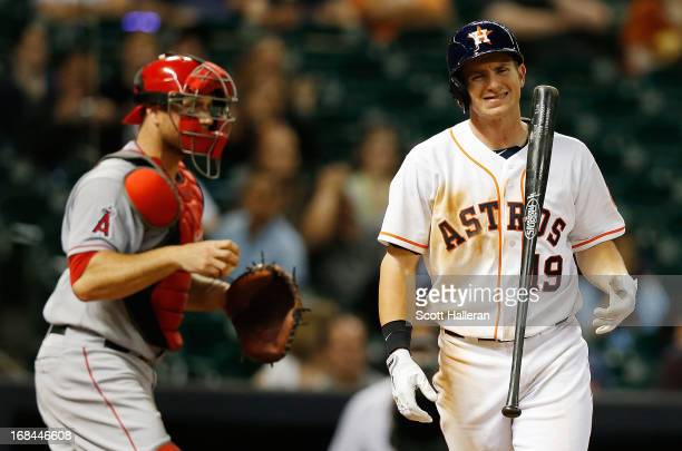 Robbie Grossman of the Houston Astros reacts to a strikeout during the ninth inning as Chris Iannetta of the Los Angeles Angels of Anaheim looks on...