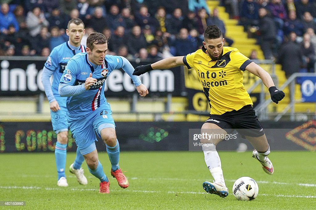 Robbie Haemhouts of Willem II Stijn Wuytens of Willem II Adnane Tighadouini of NAC Breda during the Dutch Eredivisie match between NAC Breda and...