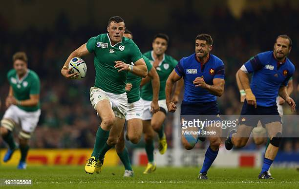Robbie Henshaw of Ireland breaks with the ball during the 2015 Rugby World Cup Pool D match between France and Ireland at Millennium Stadium on...
