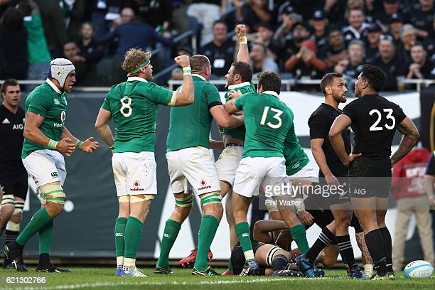 Robbie Henshaw of Ireland celebrates with teammates after scoring his team's fifth try during the international match between Ireland and New Zealand...