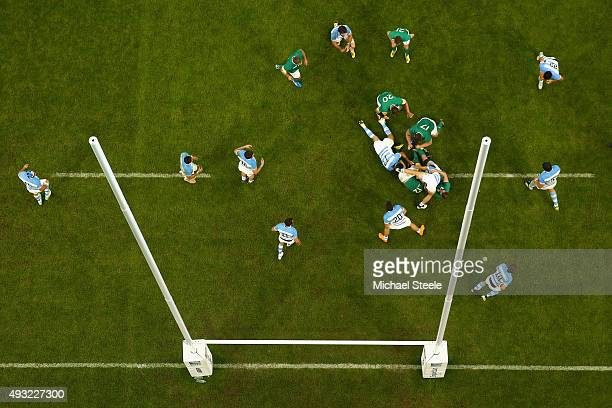 Robbie Henshaw of Ireland is held up by Lucas Noguera Paz of Argentina during the 2015 Rugby World Cup Quarter Final match between Argentina and...
