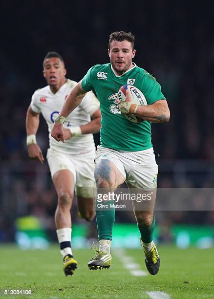 Robbie Henshaw of Ireland is pursued by Anthony Watson of England during the RBS Six Nations match between England and Ireland at Twickenham Stadium...