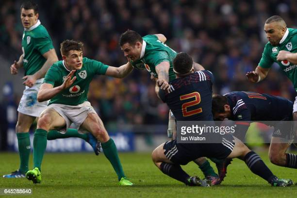 Robbie Henshaw of Ireland is tackled by Guilhem Guirado of France during the RBS Six Nations match between Ireland and France at the Aviva Stadium on...