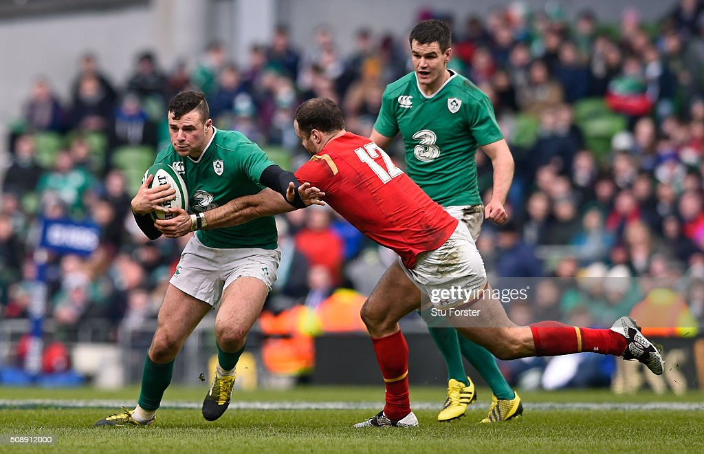 <a gi-track='captionPersonalityLinkClicked' href=/galleries/search?phrase=Robbie+Henshaw&family=editorial&specificpeople=10060659 ng-click='$event.stopPropagation()'>Robbie Henshaw</a> of Ireland is tackled by <a gi-track='captionPersonalityLinkClicked' href=/galleries/search?phrase=Jamie+Roberts&family=editorial&specificpeople=3530992 ng-click='$event.stopPropagation()'>Jamie Roberts</a> of Wales during the RBS Six Nations match between Ireland and Wales at the Aviva Stadium on February 7, 2016 in Dublin, Ireland.