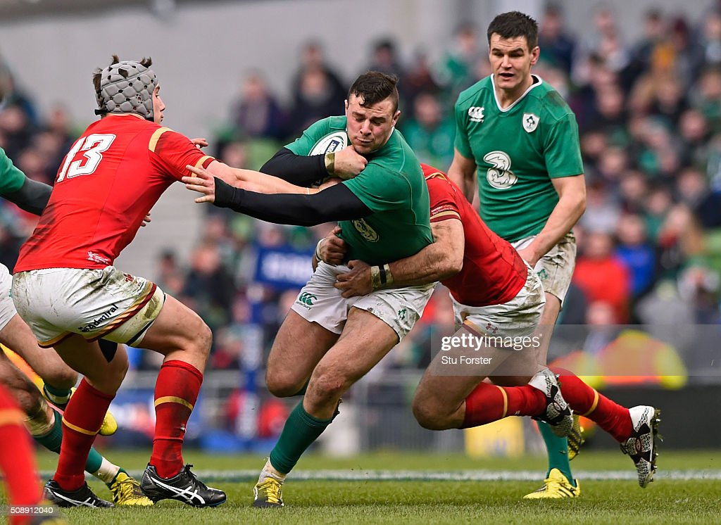 <a gi-track='captionPersonalityLinkClicked' href=/galleries/search?phrase=Robbie+Henshaw&family=editorial&specificpeople=10060659 ng-click='$event.stopPropagation()'>Robbie Henshaw</a> of Ireland is tackled by <a gi-track='captionPersonalityLinkClicked' href=/galleries/search?phrase=Jonathan+Davies+-+Jugador+de+rugby+-+nacido+en+1988&family=editorial&specificpeople=8522336 ng-click='$event.stopPropagation()'>Jonathan Davies</a> (L) and <a gi-track='captionPersonalityLinkClicked' href=/galleries/search?phrase=Jamie+Roberts&family=editorial&specificpeople=3530992 ng-click='$event.stopPropagation()'>Jamie Roberts</a> (R) of Wales during the RBS Six Nations match between Ireland and Wales at the Aviva Stadium on February 7, 2016 in Dublin, Ireland.