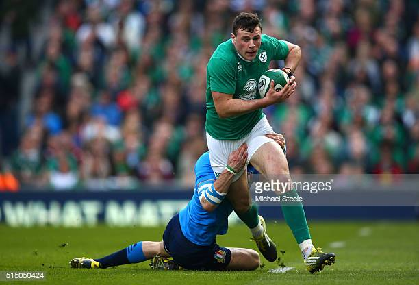 Robbie Henshaw of Ireland is tackled during the RBS Six Nations match between Ireland and Italy at Aviva Stadium on March 12 2016 in Dublin Ireland