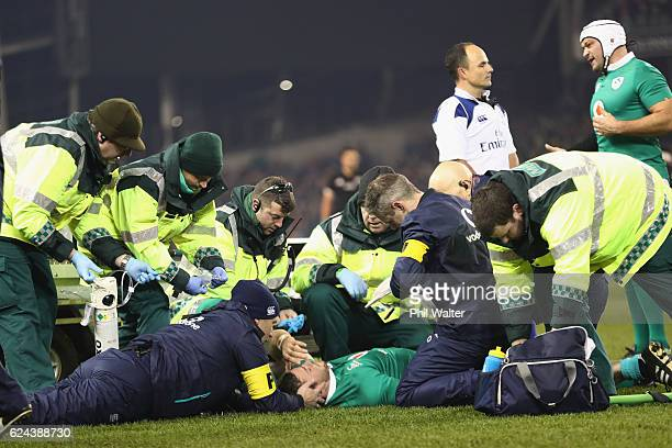 Robbie Henshaw of Ireland is taken from the field injured during the international rugby match between Ireland and the New Zealand All Blacks at...