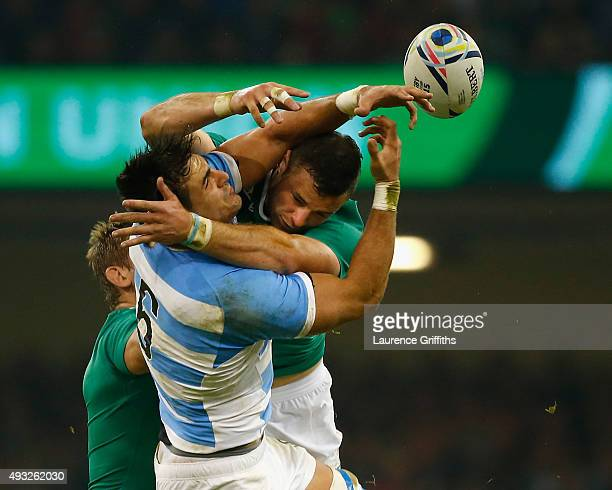 Robbie Henshaw of Ireland jumps for the ball with Pablo Matera during the 2015 Rugby World Cup Quarter Final match between Ireland and Argentina at...