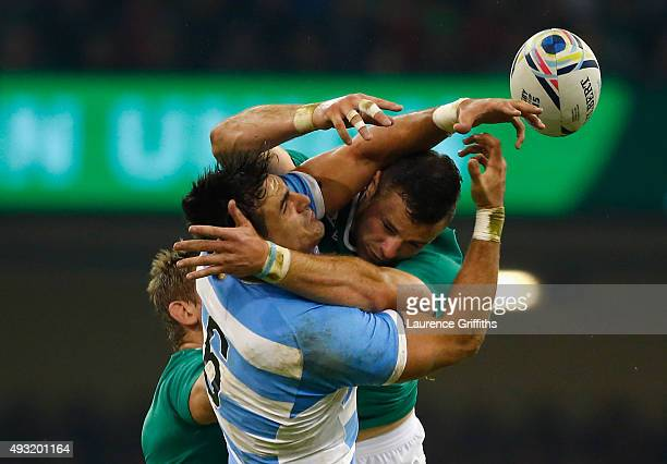 Robbie Henshaw of Ireland jumps for the ball with Pablo Matera of Argentina during the 2015 Rugby World Cup Quarter Final match between Ireland and...