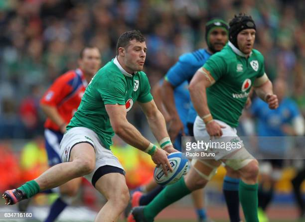 Robbie Henshaw of Ireland passes the ball during the RBS Six Nations match between Italy and Ireland at Stadio Olimpico on February 11 2017 in Rome...