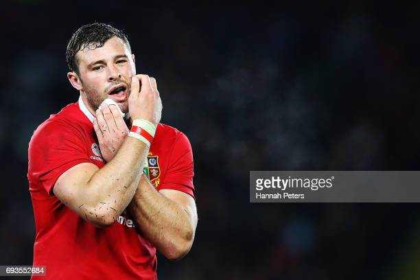 Robbie Henshaw of the Lions holds his injured chin during the match between the Auckland Blues and the British Irish Lions at Eden Park on June 7...