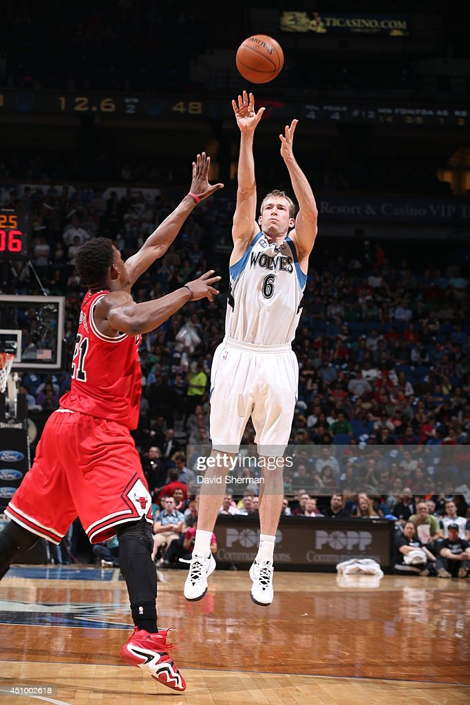 <a gi-track='captionPersonalityLinkClicked' href=/galleries/search?phrase=Robbie+Hummel&family=editorial&specificpeople=4877478 ng-click='$event.stopPropagation()'>Robbie Hummel</a> #6 of the Minnesota Timberwolves takes a shot against the Chicago Bulls during the game on April 9, 2014 at Target Center in Minneapolis, Minnesota.