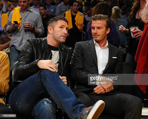Robbie Keane and David Beckham attend a basketball game between the Dallas Mavericks and the Los Angeles Lakers at Staples Center October 30 2012 in...