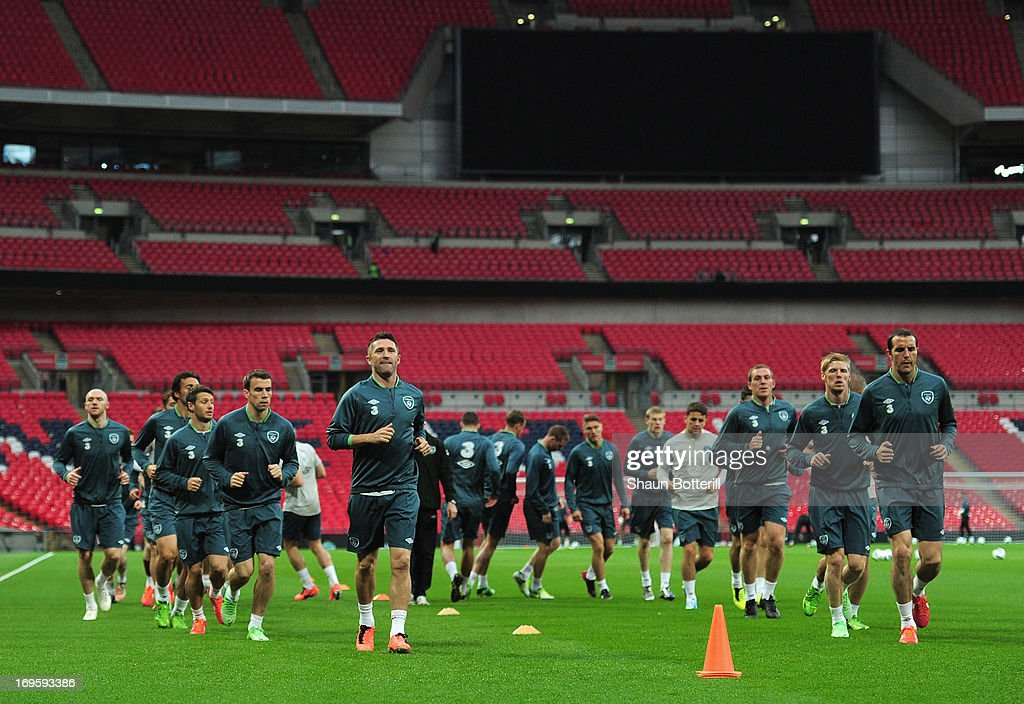 Robbie Keane and John O'Shea of Republic of Ireland lead the warm-up during training ahead of their international friendly against England at Wembley Stadium on May 28, 2013 in London, England.