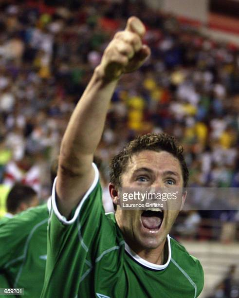 Robbie Keane of Ireland celebrates after scoring the equalising goal in the Group E match against germany at the World Cup Group Stage played at the...