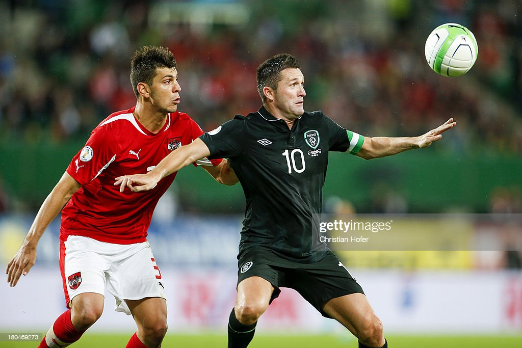 Robbie Keane of Ireland (R) challenges Aleksandar Dragovic of Austria during the FIFA World Cup 2014 Group C qualification match between Austria and the Republic of Ireland at the Ernst Happel Stadium on September 10, 2013 in Vienna, Austria.
