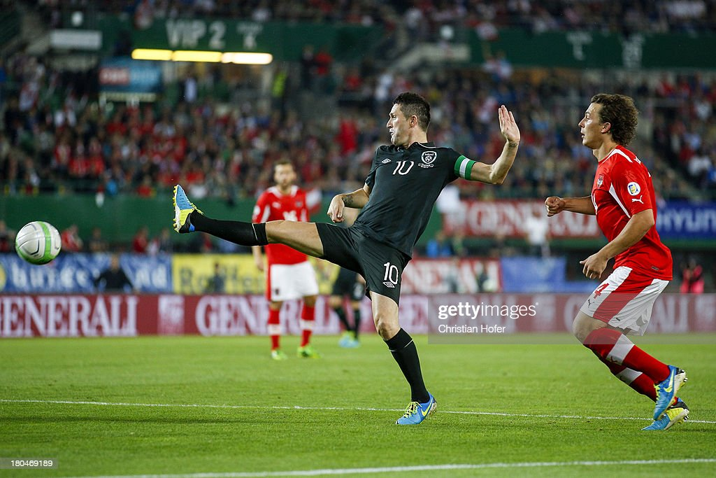 Robbie Keane of Ireland (L) challenges Julian Baumgartlinger of Austria during the FIFA World Cup 2014 Group C qualification match between Austria and the Republic of Ireland at the Ernst Happel Stadium on September 10, 2013 in Vienna, Austria.