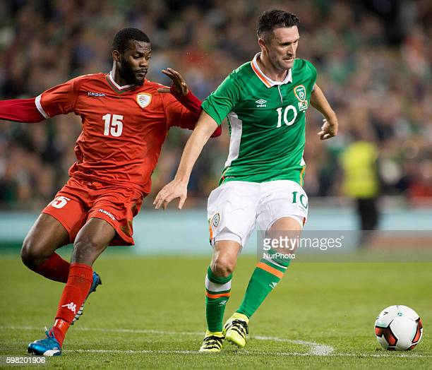 Robbie Keane of Ireland fights for the ball with Mataz Raboh Bait of Oman during the International Friendly football match between Republic of...