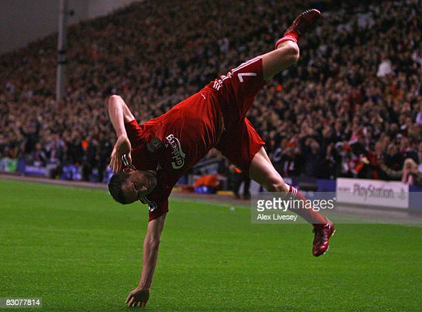 Robbie Keane of Liverpool celebrates scoring his team's second goal during the UEFA Champions League Group D match between Liverpool and PSV...