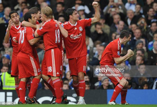 Robbie Keane of Liverpool celebrates with his team mates after Xabi Alonso of Liverpool scored the first goal during the Barclays Premier League...