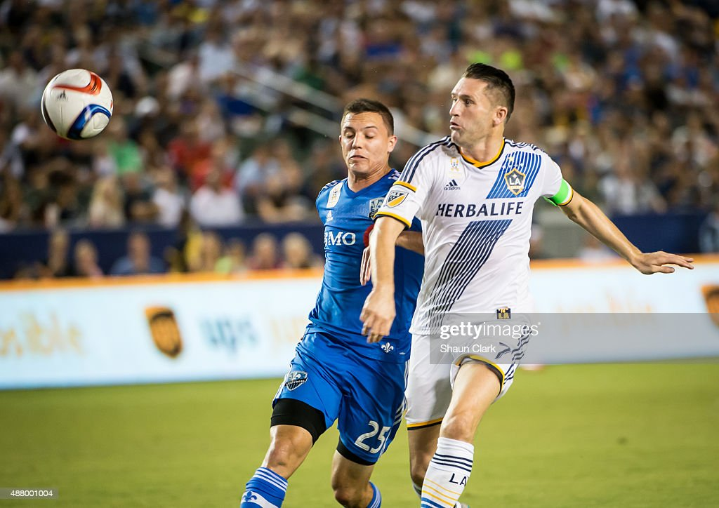 Robbie Keane #7 of Los Angeles Galaxy breaks in on goal as he is defended by Donny Toia #25 of Montreal Impact during Los Angeles Galaxy's MLS match against Montreal Impact at the StubHub Center on September 12, 2015 in Carson, California. The match ended in 0-0 tie