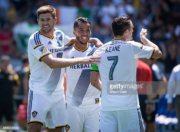 Robbie Keane of Los Angeles Galaxy celebrates his first goal with Steven Gerrard and Giovani Dos Santos during the Los Angeles Galaxy's MLS match...