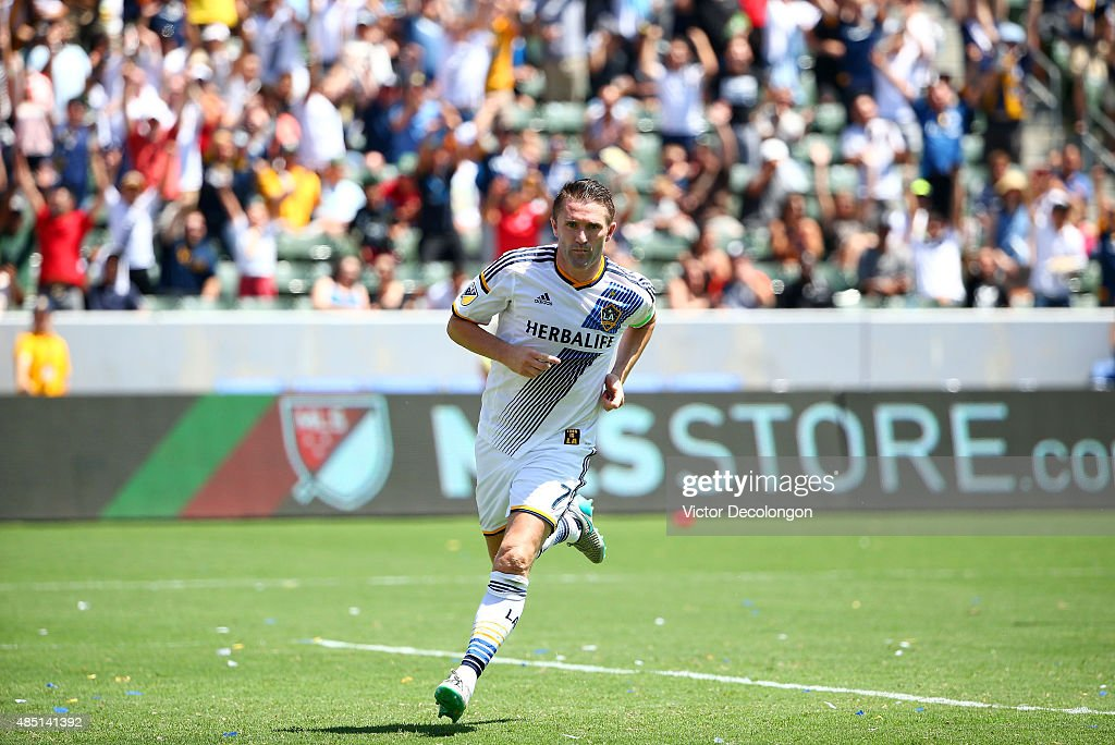Robbie Keane #7 of Los Angeles Galaxy runs toward the corner to celebrate his first goal of the match against the New York City FCin the second half of the MLS match at StubHub Center on August 23, 2015 in Los Angeles, California. The Galaxy defeated NYCFC