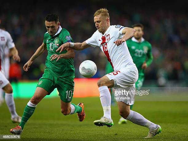 Robbie Keane of Republic of Ireland and Kamil Glik of Poland compete for the ball during the EURO 2016 Qualifier match between Republic of Ireland...