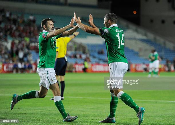 Robbie Keane of Republic of Ireland celebrates with Jon Walters after scoring Ireland's 2nd goal during the UEFA EURO 2016 Qualifier between...