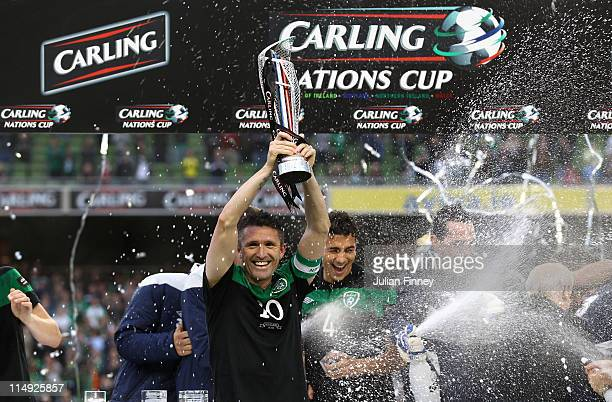 Robbie Keane of Republic of Ireland lifts the Four Nations Cup after their win over Scotland at the Aviva Stadium on May 29 2011 in Dublin Ireland
