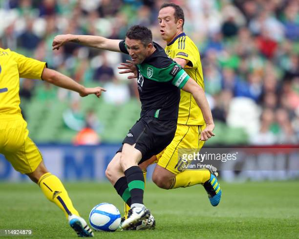 Robbie Keane of Republic of Ireland shoots and scores the openning goal as Charlie Adam of Scotland tries to stop during the Carling Nations Cup...