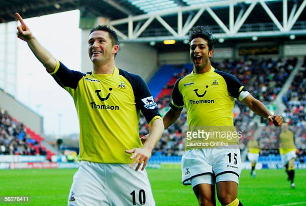 Robbie Keane of Spurs is congratulated on his goal by Hossam Ahmed Mido during the Barclays Premiership match between Wigan Athletic and Tottenham...