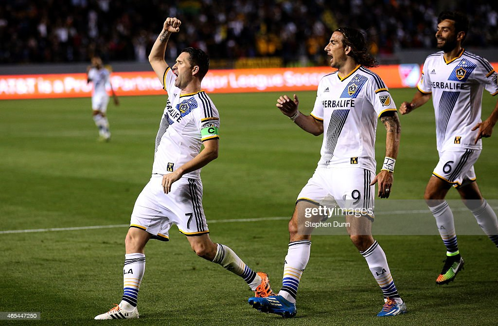 <a gi-track='captionPersonalityLinkClicked' href=/galleries/search?phrase=Robbie+Keane&family=editorial&specificpeople=171824 ng-click='$event.stopPropagation()'>Robbie Keane</a> #7 of the Los Angeles Galaxy celebrates with <a gi-track='captionPersonalityLinkClicked' href=/galleries/search?phrase=Alan+Gordon+-+Voetballer&family=editorial&specificpeople=11667134 ng-click='$event.stopPropagation()'>Alan Gordon</a> #9 and Baggio Husidic #6 after scoring the Galaxy's second goal in the second half against the Chicago Fire at StubHub Center on March 6, 2015 in Los Angeles, California. The Galaxy won 2-0.